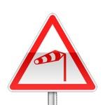 Panneau de danger annonçant un vent latéral